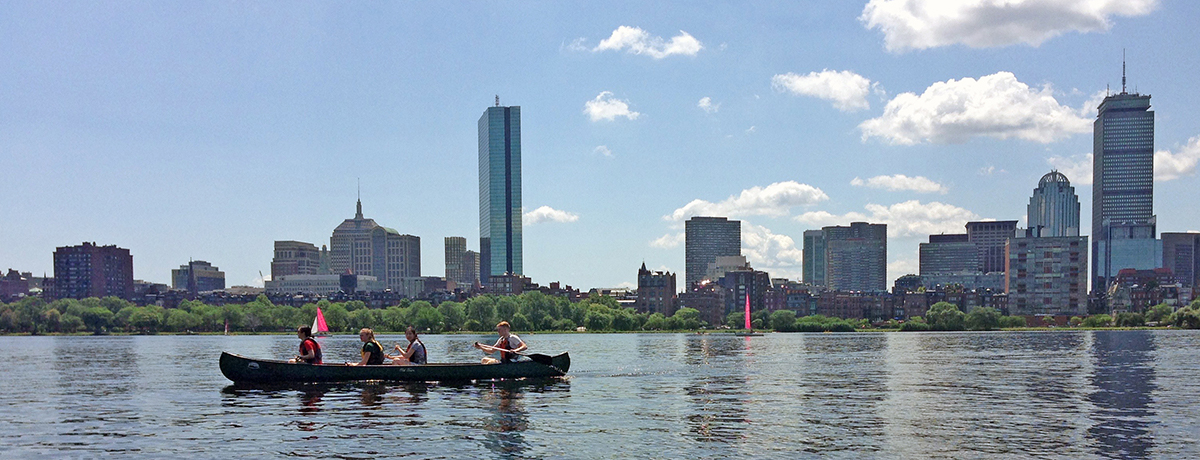 Summer Institute students canoeing on Boston's Charles River