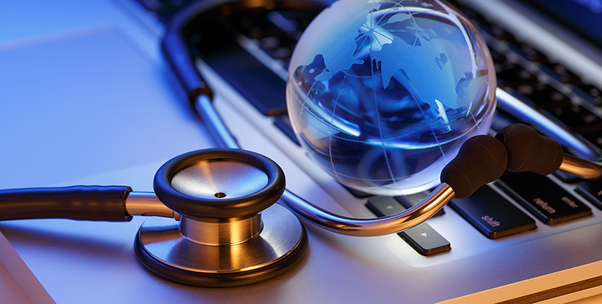 laptop, stethoscope, globe